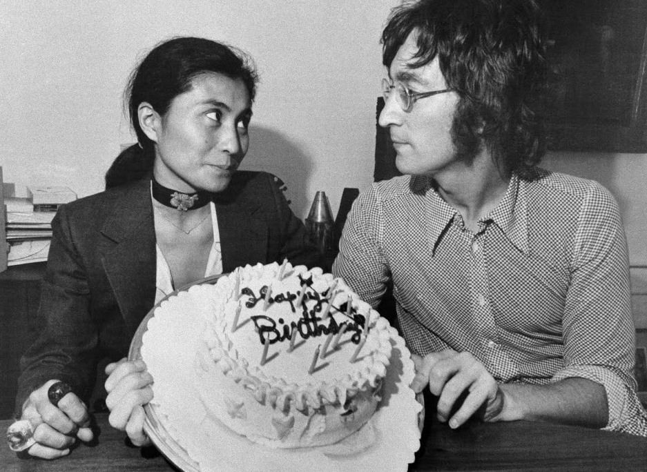 "Original Caption: Former Beatle John Lennon and his wife Yoko Ono pose with a birthday cake. Today is Lennon's 31st birthday. They are in Syracuse for the opening of Yoko Ono's first one-woman show called, ""This is Not Here...An Exhibit of Conceptual Works of Art."""