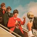 John, Ringo and Paul de-planing.