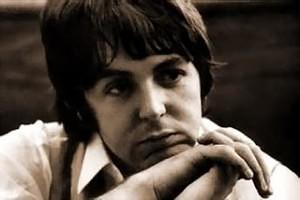 Brown tinted photo of Paul McCartney