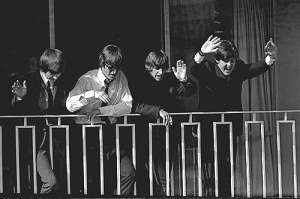 The Beatles wave from a balcony