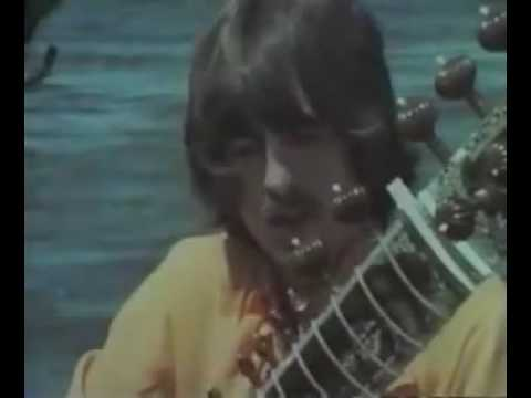 George playing sitar with Ravi Shankar in 1968