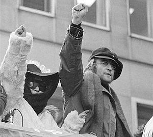 John and Yoko raising their fists