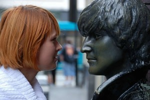 Woman and Lennon statue